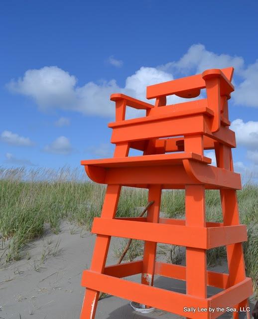 At the Beach: A Bright Orange Beach Chair