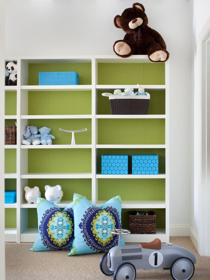 Add unexpected color to a white room by painting the back end of a bookcase in a hot hue, like this fresh yellow-green hue.