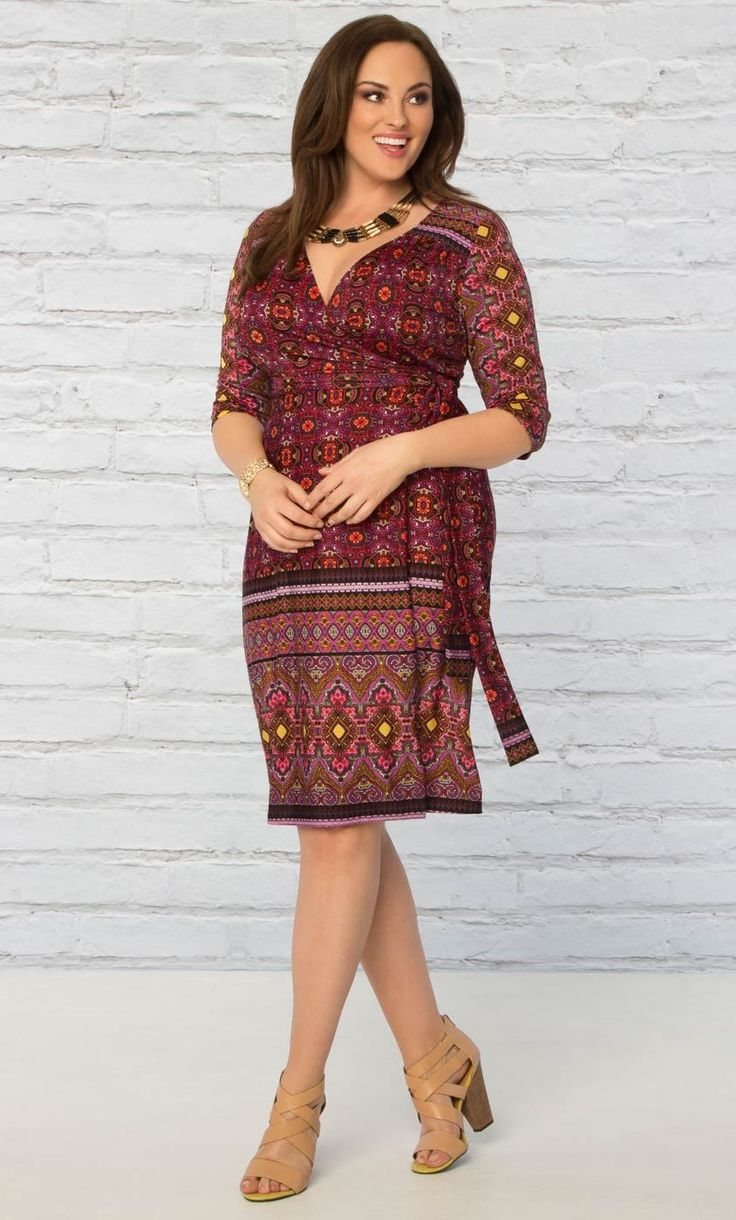A classic wrap cocktail dress in a bold print is just what any wardrobe needs. Our Beguiling Border Wrap Dress is a fully functional wrap designed in a batik print for a little bohemian flair. 3/4 sleeves and an A-line silhouette will keep you comfy and flatter every curve. Available exclusively in women's plus sizes.  Made in the USA   95% Polyester, 5% Spandex   We recommend machine washing inside out on the gentle cycle, in cold water and no bleach. Lay flat to dry and low iron when…
