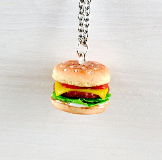A cheeseburger charm sculpted from polymer clay, available on a necklace or clasp.  In 2008, Burger King released a meat-scented cologne called Flame which they said was the scent of seduction with a hint of flame-broiled meat. Personally I think it would be better to express your love of burgers by wearing this necklace!  Attachments to choose from; - Silver plated 18 inch chain - Stainless steel 18 inch chain (the darker chain in the last photo) - Keyring / Bag Clasp (the large clasp in…