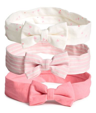 Pink. Jersey headbands with an attached bow at front and elastication at back.