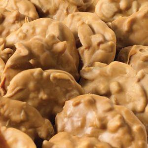 Prejean's  Pralines ½ cup butter 1 ¾ cups  sugar ½ pound light brown sugar 2 cups heavy cream 2 tablespoons vanilla 1 lb. pecans
