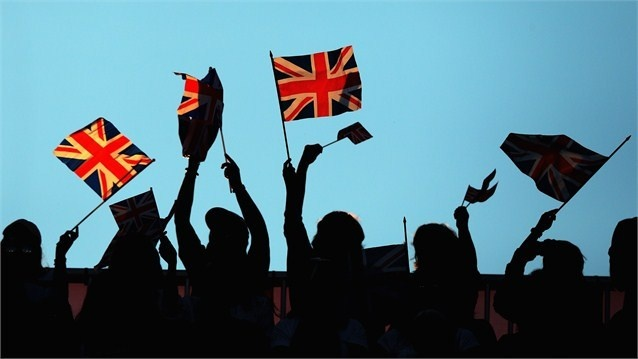 Team GB fans wave flags prior to the women's Hockey semi-final match between Argentina and Great Britain on Day 12.