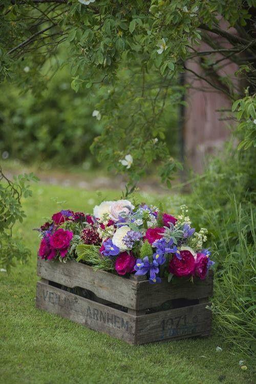 Valentine's day flower planter idea using wooden crates.