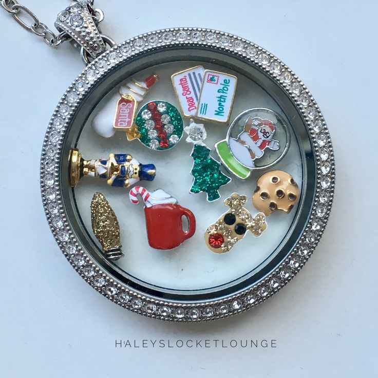 Cutest origami owl Christmas/holiday charms in a gorgeous legacy locket! https://haleyslocketlounge.origamiowl.ca