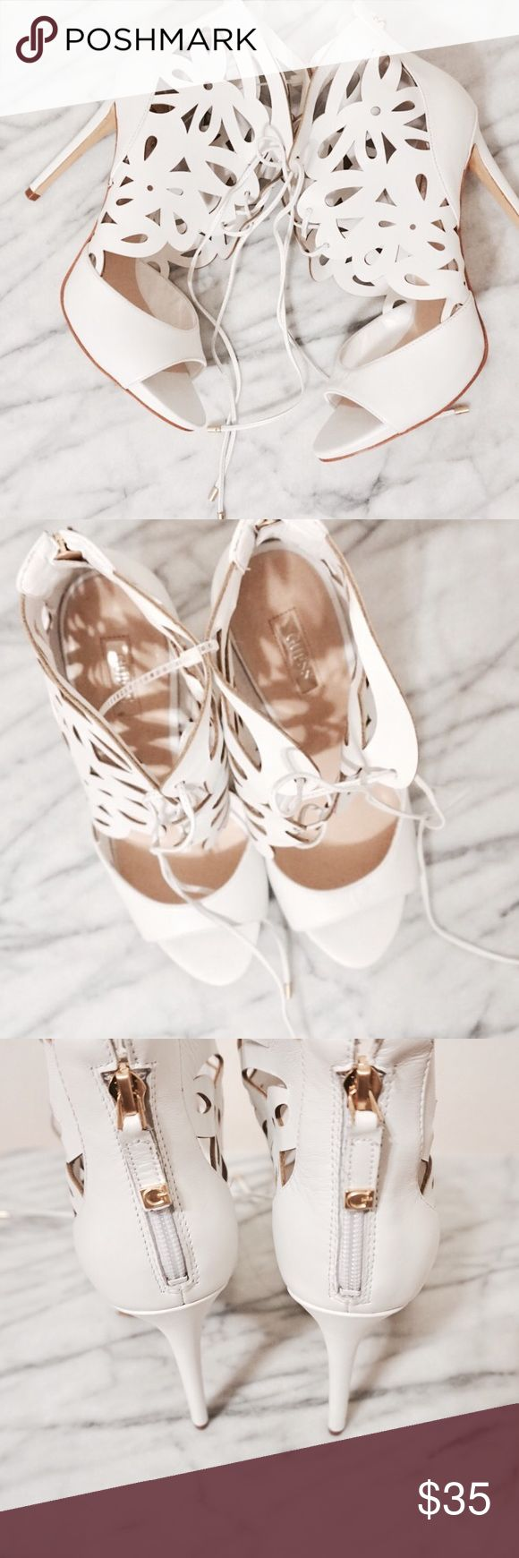 NWT white laser cut heels Genuine leather upper. Lace-up construction leads to tie closure at ankle. Decorative cut-out detail. Open toe. Rear zipper. Man-made lining and footbed. Wrapped stiletto heel. Man-made sole. New with tags! Never worn! ❤ Guess Shoes Heels
