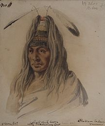 """Paul Kane's objective, according to the preface of his book """"Wanderings of an Artist,"""" was to """"sketch pictures of the principal chiefs, and their original costumes, to illustrate their manners and customs, and to represent the scenery of an almost unknown country."""" """"Culchillum Wearing a Medicine Cap,"""" April–June 1847, Stark Museum of Art."""