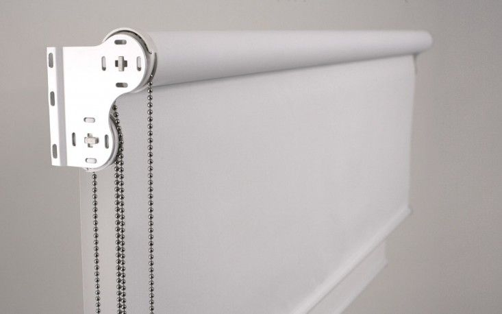 double roller blind with sheer fabric on one roller and a blackout shade on the other