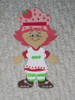 """Strawberry Shortcake- Creator said """"I used ragdoll girl pg 37 cut the following out of white: hat, bottoms, socks & apron cut the following out of red: bow, hair & shirt cut the following out of black: shoes Then with a red marker I put """"x""""s along the bottom of the apron. Then with a green marker I put 4 diamond across the middle of the apron and the I put green strips on the socks and finished with a black marker for the buttons on the apron. If you want and can find strawber..."""