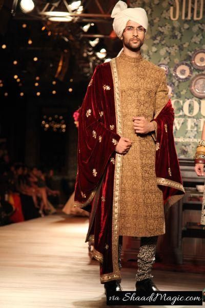 Maroon Velvet Stole  A sherwani of 3 different patterns of clothes. The top, stole and pant does not match each other, but it can surely match your bride to be in her red wedding outfit.