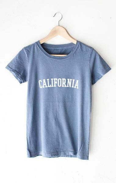 "- Description Details: 'California' relaxed fit destroyed tee in vintage blue with unfinished hem & grinding on neck and bottom hem. Brand: NYCT Clothing Measurements: (Size Guide) S: 34"" bust, 24.5"""