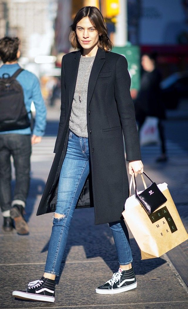 Alexa Chung - Alexa shows us that even a classic pair of Vans can be elevated to new heights by way of a perfectly structured black coat and cropped jeans.