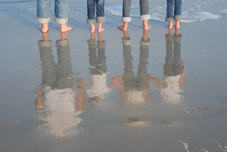 Our family picture at the beach...anywhere there is water around, use it as a reflection of some sort. I have this hung up in my homeschooling room.
