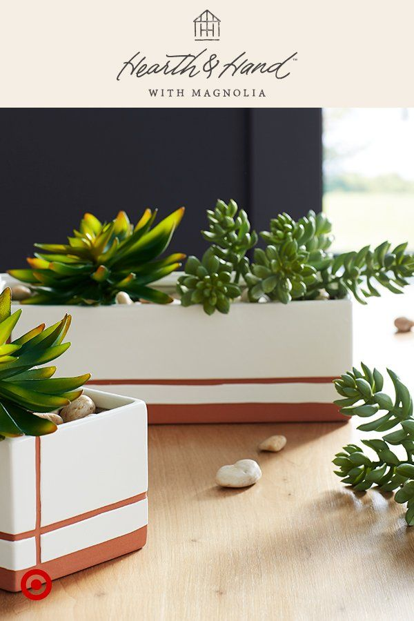 Planters with artificial succulents bring any space