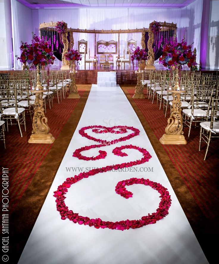 Indian Wedding, Boynton Beach BAPS Mandir, Suhaag Garden, Indian wedding decorators, Florida wedding decorators, wooden carved mandap, golden candlestick, flowers, aisle, roses scroll