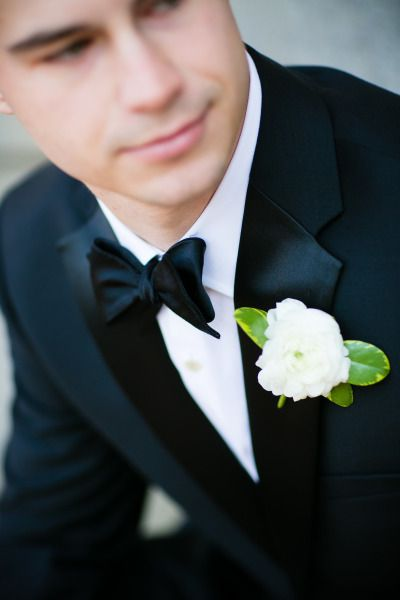 Ranunculus boutonniere: http://www.stylemepretty.com/maryland-weddings/baltimore/2015/05/17/baltimore-george-peabody-library-wedding/ | Photography: Maria Linz - http://www.marialinzphotographyblog.com/