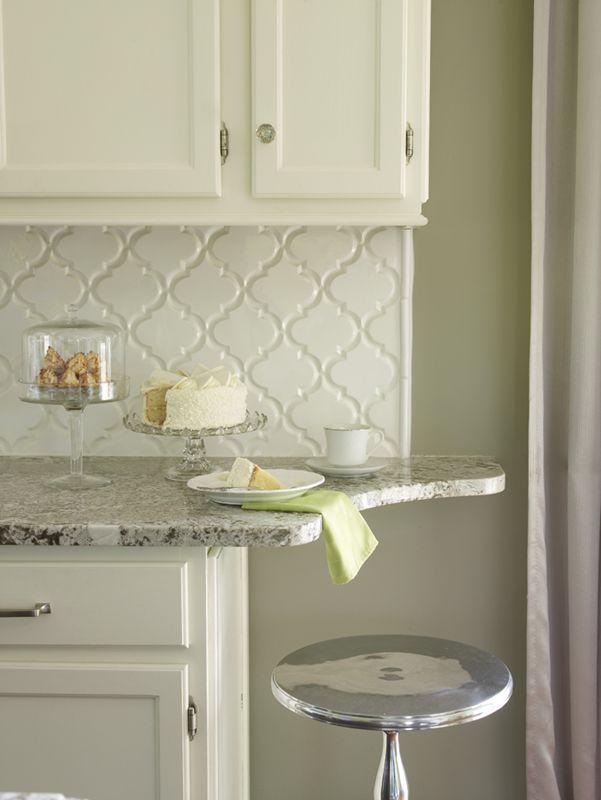 Creamy white kitchen cabinets with Bianco Antico