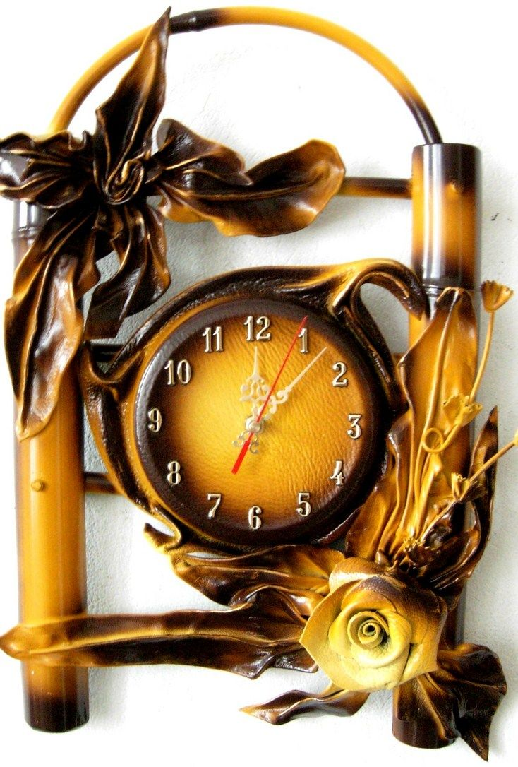 Brown,Gold Leather Wall Hanging Clock with Bamboo www.makmarketplace.com View a huge selection of Leather Clock's with eco-friendly and sustainable Bamboo.In our wall clocks collection you will find the styles to suit any taste or fit any home and office, store or building decor. These very unique Leather Clock with eco-friendly and sustainable Bamboo. Have a high quality embellished work and unique hand crafted with grapes and leaf accents.