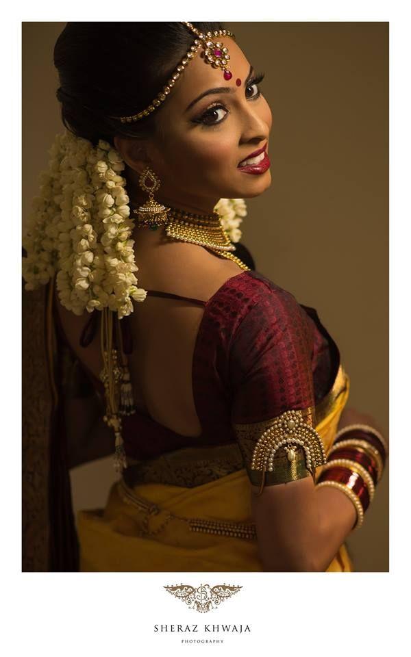 South Indian bride. Temple jewelry. Jhumkis.Mustard and maroon silk kanchipuram sari.Braid with fresh flowers. Tamil bride. Telugu bride. Kannada bride. Hindu bride. Malayalee bride.Kerala bride.South Indian wedding.