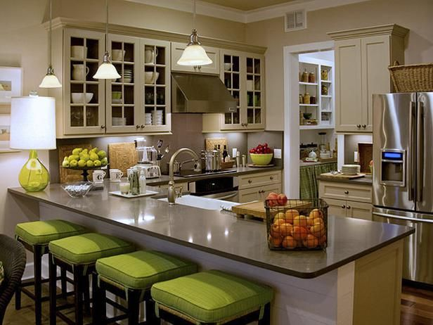 15 Cottage Kitchens: In the 2008 HGTV Green Home, designer Linda Woodrum expertly blended a seaside palette of gray cabinets and beige countertops, and pumped it up with apple-colored cushions on the barstools. From DIYnetwork.com