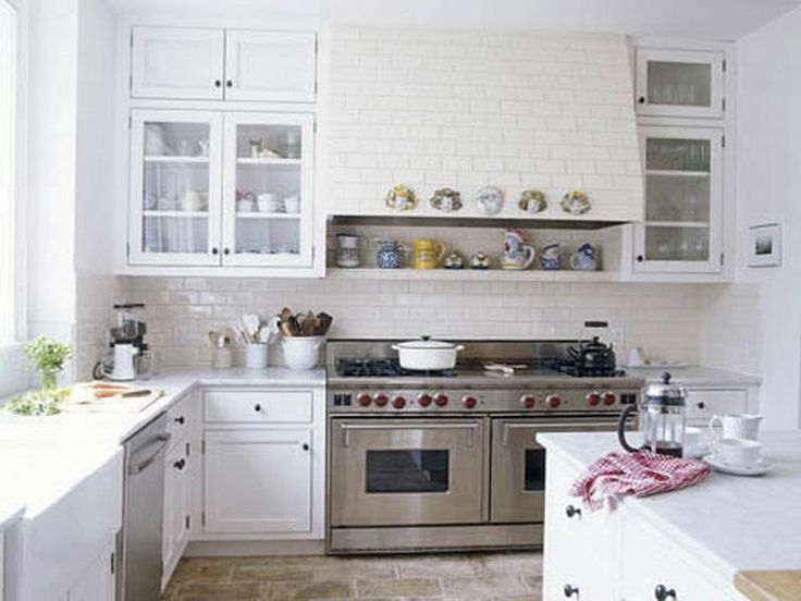 All white small kitchens kitchen pinterest for Small kitchens with white cabinets