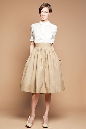 Beige Cotton Midi Skirt | Mrs Pomeranz in Moscow, Russia | Etsy | A gently pleated midi skirt (with side pockets). Closes down side with hidden zipper and a button.