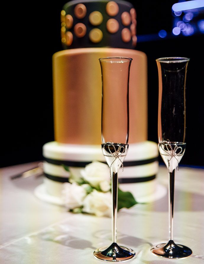 Orange ane black wedding cake, and champagne glasses http://www.millgrovephotography.com.au/maia-docklands-wedding-dome-333-collins/