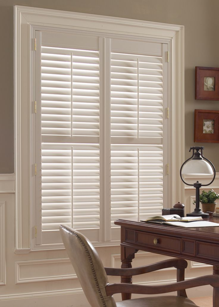 Plantation shutters add a touch of classic elegance to the home office. Budget Blinds of Benton