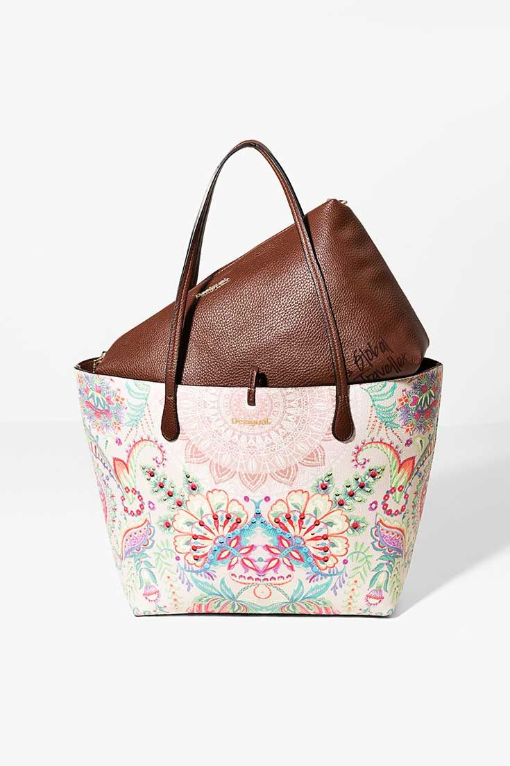 Reversible shopper with a small bag/cosmetic bag inside.