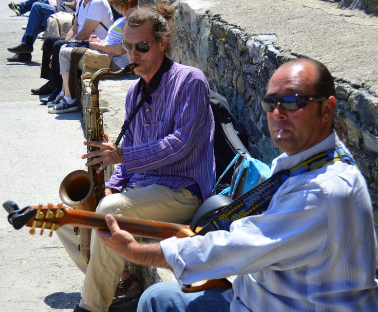 Musicians performing on the waterfront in Collioure, France