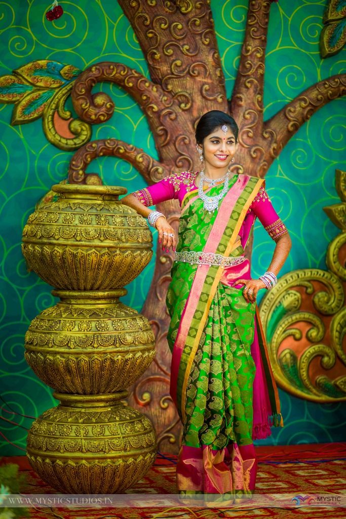 South Indian bride. Gold Indian bridal jewelry.Temple jewelry. Jhumkis. Bright green with pink silk kanchipuram sari.Side braid with fresh jasmine flowers. Tamil bride. Telugu bride. Kannada bride. Hindu bride. Malayalee bride.Kerala bride.South Indian wedding.