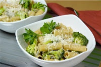 1 bunch broccoli  1 package (16 ounces/450 g) ziti macaroni  2 tablespoons (30 ml) olive oil  1 clove garlic, minced  ¾ cup (3 ounces/90 g) shredded American or mozzarella cheese  ½ cup (125 ml) grated Parmesan  ¼ cup (60 ml) butter  ¼ cup (60 ml) chicken broth  3 tablespoons (45 ml) white wine
