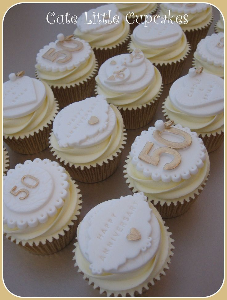 50th Wedding Anniversary cupcakes decorated with fondant toppers highlighted with gold x