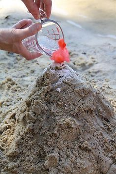 Volcano Beach Fun! Build up sand around a bottle to form the volcano. Pour water into the bottle. Squeeze red food coloring into the water. Measure out 2 tablespoons of baking soda and pouring it into the bottle. pour in white vinegar, and watch the lava explode!!