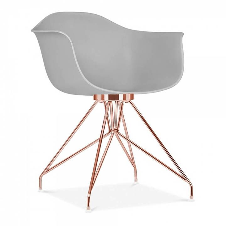dining #armchair with #RoseGold or #Copper steel leg base and deep coloured chair seat | #Ad
