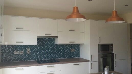 Kitchen remodel -white kitchen with blue splashback in herringbone pattern