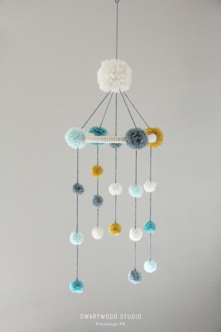 Baby Pom Mobile in Aquas and Light Mustard (Medium) by SwartwoodStudio on Etsy https://www.etsy.com/listing/249038522/baby-pom-mobile-in-aquas-and-light