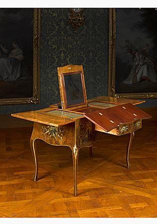 "David Roentgen (Herrenhag i.d. Wetterau 11.8.1743 - Wiesbaden 12.2.1807) Table de toilette or ""coiffeuse"" Roentgen manufactory, Neuwied, 1770/75 Stained maple (""bois de tabac"") and other light veneer woods, rosewood, carcase in oak and pine, cedar, cherry, brass, iron, ormolu mounts, silver.."