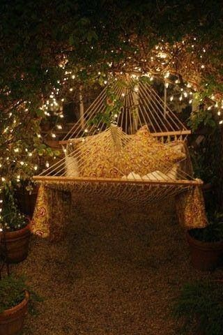 Hammock + mini lights in tree.  I really must bury some electrical lines in pipes in the yard for and with protected outlets so I can string lights in trees around the yard without cords running everywhere.  I could hide the outlets behind the doors of little Fairy houses.