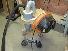 Mini Cyclone for a Shop Vacuum by mreza -- Homemade mini cyclone for a shop vacuum constructed from sheetmetal, MDF, and flexible hose. http://www.homemadetools.net/homemade-mini-cyclone-for-a-shop-vacuum