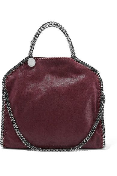 Trimmed with whipstitched chains, Stella McCartney's iconic 'Falabella' bag is crafted from merlot faux brushed-leather. This incredibly soft piece has a spacious twill-lined interior, made from recycled plastic bottles, that's fitted with a zipped compartment. Carry it by the top handles or fold it over to use the shoulder strap.