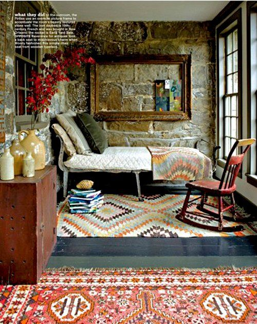 rustic, old world details.  vintage kilim rugs, natural stone, and antique pieces.