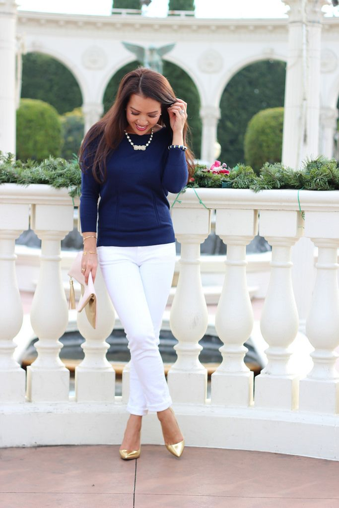Navy top, white jeans, bow statement necklace, gold bracelets, gold and pink fold over tassel clutch and gold metallic heels //  Click the following link to see all photos and details:   http://www.stylishpetite.com/2014/01/navy-white-and-gold.html