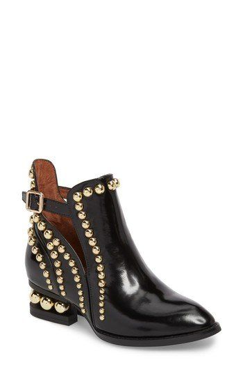 Silvery studs highlight the chic cutouts at the sides and heel of a glossy leather bootie with plenty of rock 'n' roll brio.