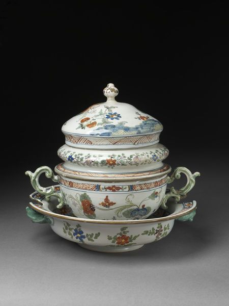 Accouchement cup with two handles, lid with two wells, outer lid with knob and stand, made in Faenza, about 1750-60, tin-glazed earthenware | V&A Search the Collections