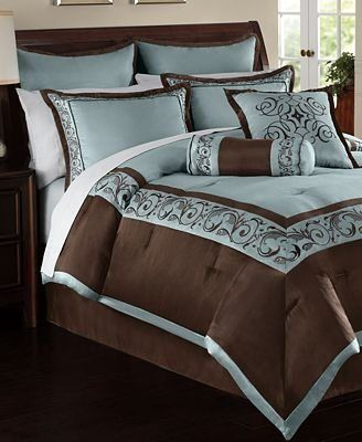 Elegant, luxurious blue and brown bedding. Looks like a luxury hotel.  blue and brown comforter set.