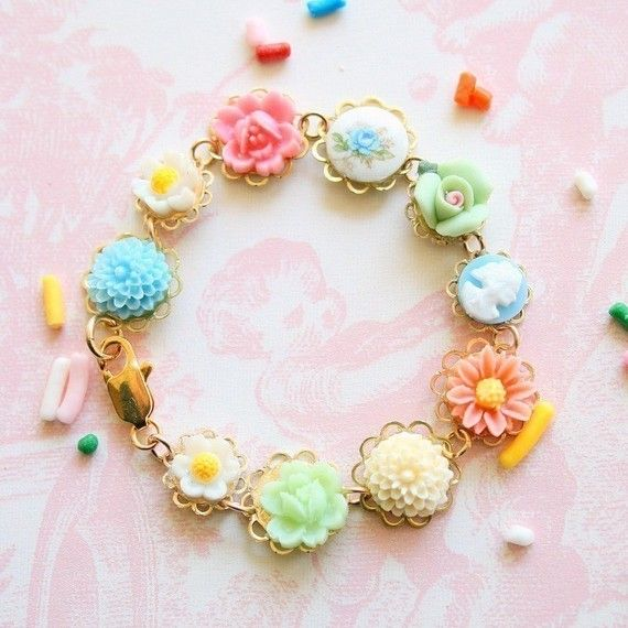 Children Pink Rose Bracelet.  This sweet bracelet is made with lots of different little vintage and new flower cabs( 7-10mm) in pastel