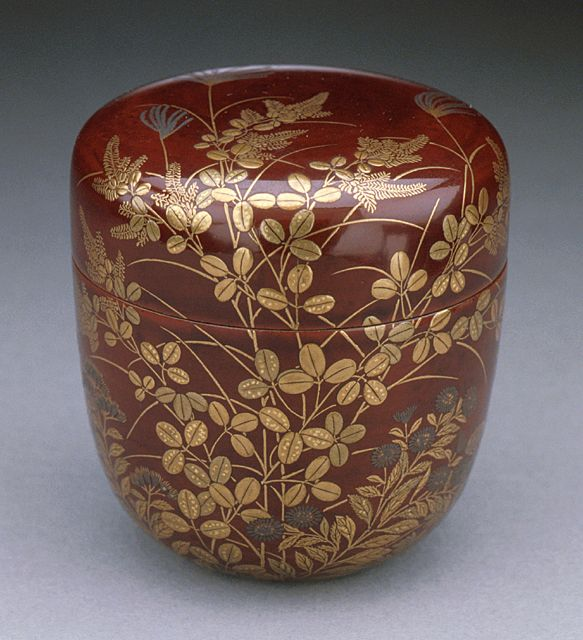 Covered Tea Carrier with Design of Autumn Grasses, 19th century  Lacquer, Red lacquer with gold leaves, grasses, and flowers, 2 5/8 x 2 3/8 in. (6.7 x 6.0 cm) Gift of Miss Bella Mabury (M.39.3.39a-b)