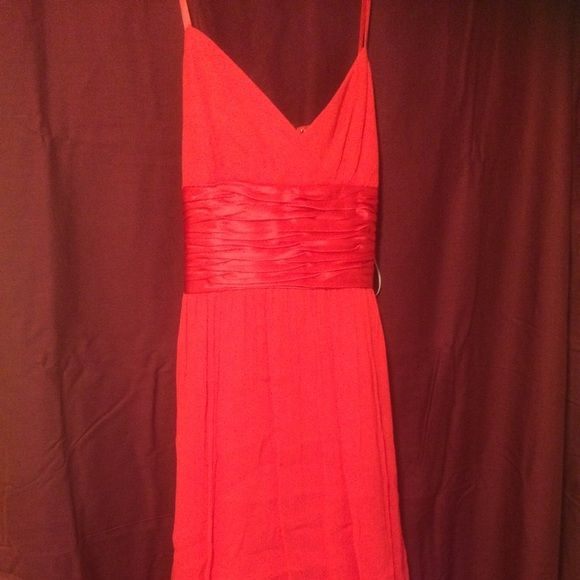 Maggs London Size 6 cocktail dress: NWT nvr worn! A mix of hot pink/red silk cocktail dress with spaghetti straps and silk sash around waist to be tied in a bow in back. Perfect for weddings or graduations. Never worn. Brand new with tags. Maggy London Dresses
