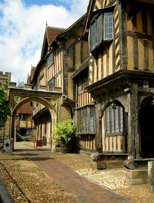 Warwick, England, UK.  See the tea shop tucked away just past the archway?